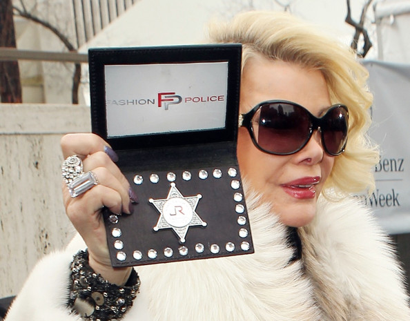 Joan+Rivers+flashes+Fashion+Police+badge+around+c2x88brbJh7l